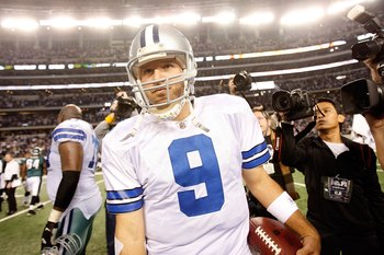ARLINGTON, TX - JANUARY 09:  Quarterback Tony Romo #9 of the Dallas Cowboys during the 2010 NFC wild-card playoff game at Cowboys Stadium on January 9, 2010 in Arlington, Texas.  (Photo by Ronald Martinez/Getty Images)