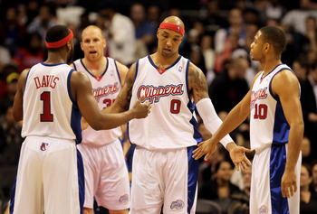 LOS ANGELES, CA - FEBRUARY 24:  Drew Gooden #0 of the Los Angeles Clippers is congratulated by Baron Davis (L) #1 and Eric Gordon (R) #10 after scoring a basket against the Detroit Pistons during the first half at Staples Center on February 24, 2010 in Lo