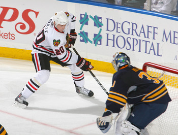BUFFALO, NY - OCTOBER 11:  Jack Skille #20 of the Chicago Blackhawks skates to the side of Ryan Miller #30 of the Buffalo Sabres  at HSBC Arena on October 11, 2010 in Buffalo, New York. Chicago won 4-3.  (Photo by Rick Stewart/Getty Images)