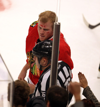 CHICAGO - OCTOBER 18: Bryan Bickell #29 of the Chicago Blackhawks heads to the penalty box after a fight with David Backes of the St. Louis Blues at the United Center on October 18, 2010 in Chicago, Illinois. (Photo by Jonathan Daniel/Getty Images)