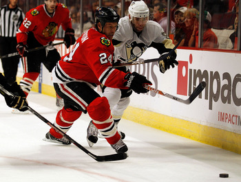 CHICAGO - OCTOBER 01: Nick Boynton #24 of the Chicago Blackhawks and Pascal Dupuis #9 of the Pittsburgh Penguins chase down the puck during a pre-season game at the United Center on October 1, 2010 in Chicago, Illinois. The Blackhawks defeated the Penguin