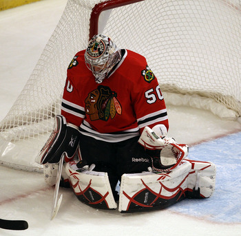CHICAGO - OCTOBER 13: Corey Crawford #50 of the Chicago Blackhawks stops a shot by Steve Sullivan of the Nashville Predators at the United Center on October 13, 2010 in Chicago, Illinois. The Predators defeated the Blackhawks 3-2. (Photo by Jonathan Danie