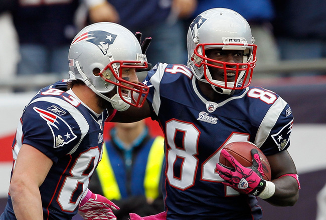 FOXBORO, MA - OCTOBER 17:  Wes Welker #83 celebrate with teammate Deion Branch #84, both of the New England Patriots, after Branch caught a touchdown pass in the second half against the Baltimore Ravens at Gillette Stadium on October 17, 2010 in Foxboro,