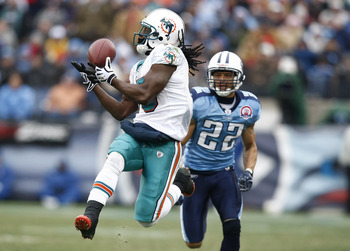 NASHVILLE, TN - DECEMBER 20: Davone Bess #15 of the Miami Dolphins catches a pass behind Vincent Fuller #22 of the Tennessee Titans at LP Field on December 20, 2009 in Nashville, Tennessee. The Titans defeated the Dolphins 27-24 in overtime. (Photo by Joe