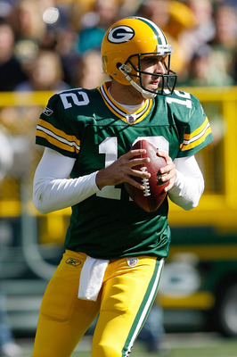 GREEN BAY, WI - OCTOBER 17: Aaron Rogers #12 of the Green Bay Packers passes against the Miami Dolphins at Lambeau Field on October 17, 2010 in Green Bay, Wisconsin. (Photo by Scott Boehm/Getty Images)