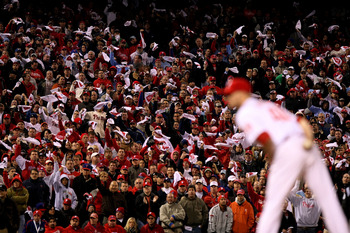 PHILADELPHIA - OCTOBER 19:  Fans of the Philadelphia Phillies wave towels as Ryan Madson #46 of the Phillies gets set to throw a pitch against the Los Angeles Dodgers in Game Four of the NLCS during the 2009 MLB Playoffs at Citizens Bank Park on October 1