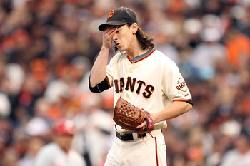 SAN FRANCISCO - OCTOBER 21:  Tim Lincecum #55 of the San Francisco Giants reacts during the third inning against the Philadelphia Phillies in Game Five of the NLCS during the 2010 MLB Playoffs at AT&T Park on October 21, 2010 in San Francisco, California.