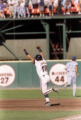 18 Sep 1997: Brian Johnson of the San Francisco Giants celebrates his home run during a game against the Los Angeles Dodgers at 3Com Park in San Francisco, California. The Giants won the game, 6-5.