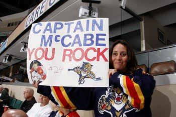 SUNRISE, FL - JANUARY 23: Florida Panthers fan Laura Stenicky holds up a sign supporting Bryan McCabe (not pictured) prior to the game against the Toronto Maple Leafs on January 23, 2010 at the BankAtlantic Center in Sunrise, Florida. The Panthers defeate