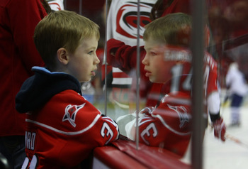 RALEIGH, NC - NOVEMBER 19: A Hurricanes fan watches warmups prior to the game between the Toronto Maple Leafs and the Carolina Hurricanes at the RBC Center on November 19, 2009 in Raleigh, North Carolina. (Photo by Bruce Bennett/Getty Images)