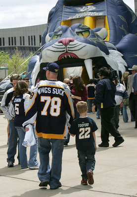 NASHVILLE, TN - APRIL 20:  A Predator fan wearing a 'Wings Suck' jersey shows up to see the Detroit Red Wings against the Nashville Predators on April 20, 2008 in game six of the Western Conference Quarterfinals of the 2008 NHL Stanley Cup Playoffs at the