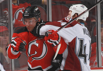 NEWARK, NJ - OCTOBER 15: Ilya Kovalchuk #17 of the New Jersey Devils gets an elbow from Ryan Wilson #44 of the Colorado Avalanche at the Prudential Center on October 15, 2010 in Newark, New Jersey.  (Photo by Bruce Bennett/Getty Images)