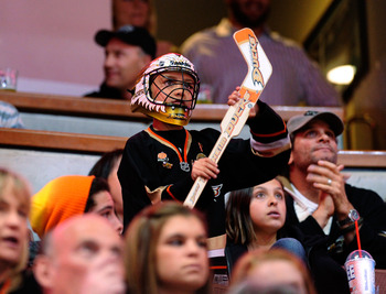 ANAHEIM, CA - NOVEMBER 23:  A fan of Anaheim Ducks cheers during the NHL game against Calgary Flames at the Honda Center on November 23, 2009 in Anaheim, California.  (Photo by Kevork Djansezian/Getty Images)