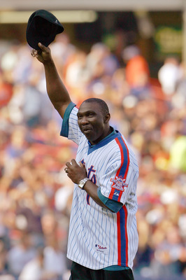 NEW YORK - OCTOBER 04:  Mookie Wilson formerly of the New York Mets waves to the fans before throwing out the first pitch for a game against the Los Angeles Dodgers in game one of the National League Division Series at Shea Stadium on October 4, 2006 in t