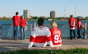 DETROIT - MAY 4:  Fans of the Detroit Red Wings sit outside the arena along the banks of the Detroit River prior to the San Jose Sharks facing the Detroit Red Wings in Game Three of the Western Conference Semifinals during the 2010 Stanley Cup Playoffs at