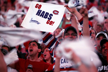 MONTREAL, QC - MAY 22:  Fans of the Montreal Canadiens cheer during Game 4 of the Eastern Conference Finals during the 2010 NHL Stanley Cup Playoffs at Bell Centre on May 22, 2010 in Montreal, Canada.  (Photo by Dave Sandford/Getty Images)