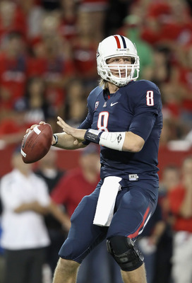 TUCSON, AZ - OCTOBER 09:  Quarterback Nick Foles #8 of the Arizona Wildcats drops back to pass during the college football game against the Oregon State Beavers at Arizona Stadium on October 9, 2010 in Tucson, Arizona.  The Beavers defeated the Wildcats 2