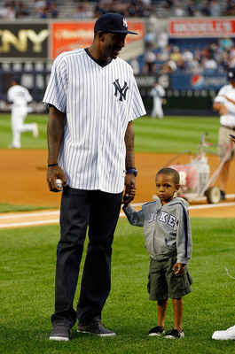 NEW YORK - SEPTEMBER 23:  Amar'e Stoudemire of the New York Knicks and his son Amar'e Jr. look on prior to the game between the New York Yankees and the Tampa Bay Rays on September 23, 2010 at Yankee Stadium in the Bronx borough of New York City.  (Photo