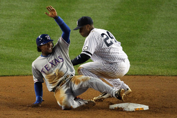 NEW YORK - OCTOBER 19: Elvis Andrus #1 of the Texas Rangers steals second base against Robinson Cano #24 of the New York Yankees in Game Four of the ALCS during the 2010 MLB Playoffs at Yankee Stadium on October 19, 2010 in the Bronx borough of New York C