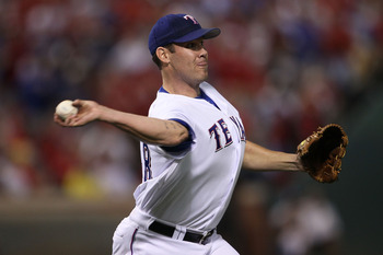 ARLINGTON, TX - OCTOBER 22:  Starting pitcher Colby Lewis #48 of the Texas Rangers pitches against the New York Yankees in Game Six of the ALCS during the 2010 MLB Playoffs at Rangers Ballpark in Arlington on October 22, 2010 in Arlington, Texas.  (Photo