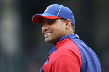 ARLINGTON, TX - OCTOBER 22:  Bengie Molina #11 of the Texas Rangers looks on during batting practice prior to playing the New York Yankees in Game Six of the ALCS during the 2010 MLB Playoffs at Rangers Ballpark in Arlington on October 22, 2010 in Arlingt