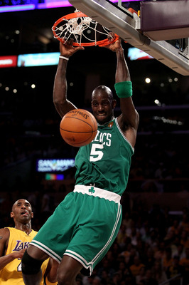 LOS ANGELES, CA - JUNE 17:  Kevin Garnett #5 of the Boston Celtics slam dunks over Kobe Bryant #24 of the Los Angeles Lakers in the first quarter of Game Seven of the 2010 NBA Finals at Staples Center on June 17, 2010 in Los Angeles, California.  NOTE TO