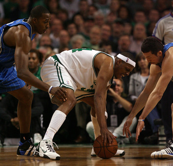 BOSTON - MAY 17:  Paul Pierce #34 of the Boston Celtics loses control of the ball as Dwight Howard #12  and Hedo Turkoglu #15 of the Orlando Magic try get the turnover in Game Seven of the Eastern Conference Semifinals during the 2009 NBA Playoffs at TD B