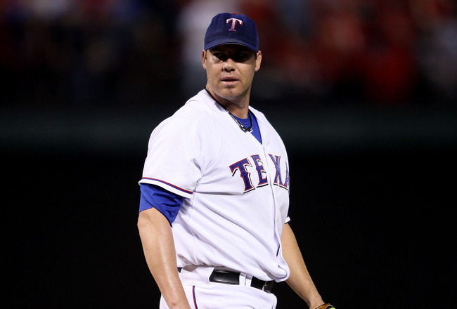 ARLINGTON, TX - OCTOBER 22:  Starting pitcher Colby Lewis #48 of the Texas Rangers looks on against the New York Yankees in Game Six of the ALCS during the 2010 MLB Playoffs at Rangers Ballpark in Arlington on October 22, 2010 in Arlington, Texas.  (Photo