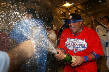 ARLINGTON, TX - OCTOBER 22:  Bengie Molina #11 of the Texas Rangers sprays champagne in the lockerroom after defeating the New York Yankees 6-1 in Game Six of the ALCS to advance to the World Series during the 2010 MLB Playoffs at Rangers Ballpark in Arli