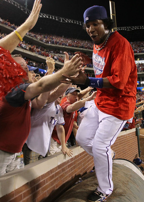 ARLINGTON, TX - OCTOBER 22:  Elvis Andrus #1 of the Texas Rangers celebrates with fans after defeating the New York Yankees 6-1 in Game Six of the ALCS to advance to the World Series during the 2010 MLB Playoffs at Rangers Ballpark in Arlington on October