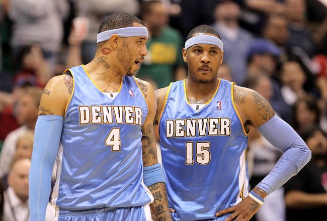 SALT LAKE CITY - APRIL 30:  Kenyon Martin #4 of the Denver Nuggets speaks to teammate Carmelo Anthony #15 during their loss to the Utah Jazz in Game Six of the Western Conference Quarterfinals of the 2010 NBA Playoffs at EnergySolutions Arena on April 30,