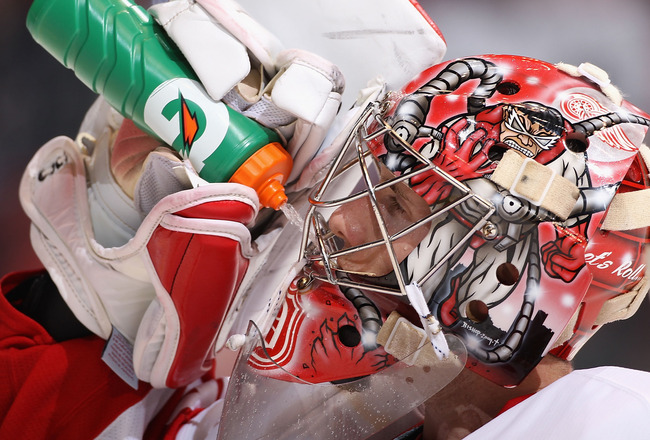 GLENDALE, AZ - OCTOBER 16:  Goaltender Jimmy Howard #35 of the Detroit Red Wings drinks water during a break from the NHL game against the Phoenix Coyotes at Jobing.com Arena on October16, 2010 in Glendale, Arizona.  The Red Wings defeated the Coyotes 2-1