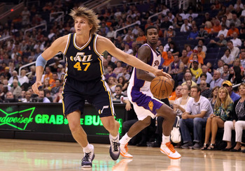 PHOENIX - OCTOBER 12:  Andrei Kirilenko #47 of the Utah Jazz drives the ball past Earl Clark #55 of the Phoenix Suns during the preseason NBA game at US Airways Center on October 12, 2010 in Phoenix, Arizona. NOTE TO USER: User expressly acknowledges and
