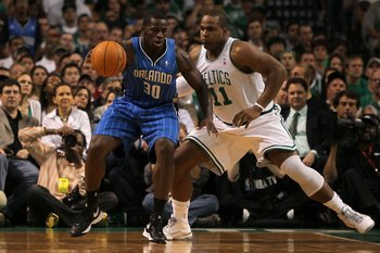 BOSTON - MAY 24:  Brandon Bass #30 of the Orlando Magic moves the ball in the post against Glen Davis #11 of the Boston Celtics in Game Four of the Eastern Conference Finals during the 2010 NBA Playoffs at TD Banknorth Garden on May 24, 2010 in Boston, Ma