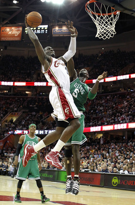 CLEVELAND - MAY 03:  J.J. Hickson #21 of the Cleveland Cavaliers gets in for a dunk past Kevin Garnett #5 of the Boston Celtics during Game Two of the Eastern Conference Semifinals during the 2010 NBA Playoffs at Quicken Loans Arena on May 3, 2010 in Clev