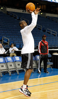 TAMPA, FL - OCTOBER 22:  Guard Dwyane Wade #3 of the Miami Heat warms up prior to the NBA preseason game against the Orlando Magic at the St. Pete Times Forum on October 22, 2010 in Tampa, Florida. NOTE TO USER: User expressly acknowledges and agrees that