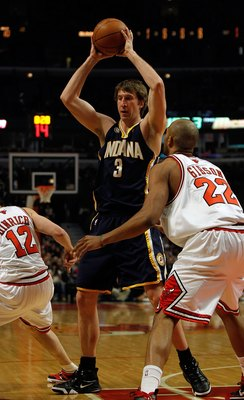 CHICAGO - FEBRUARY 24: Troy Murphy #3 of the Indiana Pacers looks to pass over Taj Gibson #22 of the Chicago Bulls at the United Center on February 24, 2010 in Chicago, Illinois. The Bulls defeated the Pacers 120-110. NOTE TO USER: User expressly acknowle