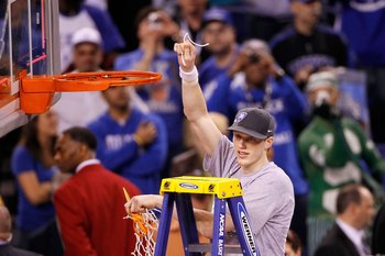 INDIANAPOLIS - APRIL 05:  Kyle Singler of the Duke Blue Devils celebrates after he cut down a piece of the net following their 61-59 win against the Butler Bulldogs during the 2010 NCAA Division I Men's Basketball National Championship game at Lucas Oil S