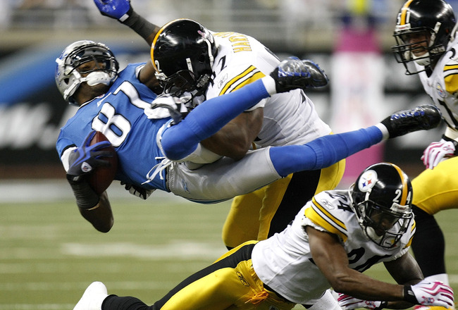 DETROIT , MI - OCTOBER 11: Calvin Johnson #81 of the Detroit Lions is tackled by James Harrison #92 of the Pittsburgh Steelers October 11, 2009 at Ford Field in Detroit, Michigan. Johnson was injured on the play. (Photo by Gregory Shamus/Getty Images)