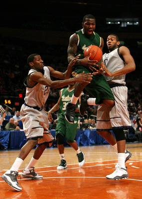 NEW YORK - MARCH 10:  Dominique Jones #20 of the USF Bulls loses control of the ball against Jason Clark #21 and Greg Monroe #10 of the Georgetown Hoyas during the second round of 2010 NCAA Big East Tournament at Madison Square Garden on March 10, 2010 in