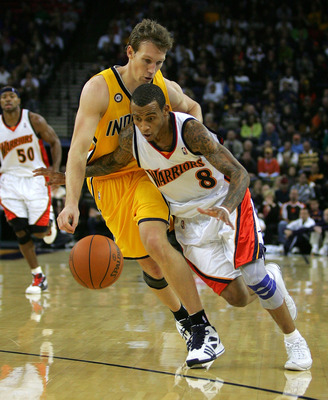 OAKLAND, CA - NOVEMBER 30:  Monta Ellis #8 of the Golden State Warriors drives past Mike Dunleavy #17 of the Indiana Pacers at Oracle Arena on November 30, 2009 in Oakland, California. Ellis finished with a career high 45 points.  (Photo by Ezra Shaw/Gett