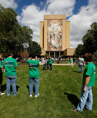 SOUTH BEND, IN - SEPTEMBER 04: Fans take pictures in front of the 'Way of Life' mural, also known as 'Touchdown Jesus,' on the campus of Notre Dame University before a game between the Notre Dame Fighting Irish and the Purdue Boilermakers at Notre Dame St