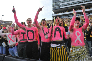 IOWA CITY, IA - OCTOBER 23: University of Iowa Hawkeyes fans cheer on their team as they take on the Wisconsin Badgers during the first half of play at Kinnick Stadium on October 23, 2010 in Iowa City, Iowa. Wisconsin won 31-30 over Iowa. (Photo by David