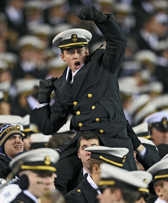 PHILADELPHIA - DECEMBER 12: A Navy Midshipmen cheers during the game against Army Black Knights on December 12, 2009 at Lincoln Financial Field in Philadelphia, Pennsylvania. Navy won 17-3. (Photo by Drew Hallowell/Getty Images)