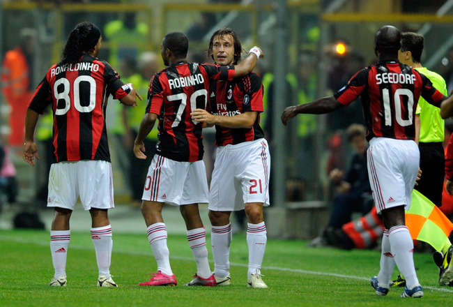 PARMA, ITALY - OCTOBER 02:  Andrea Pirlo of AC Milan celebrates after the first goal during the Serie A match between Parma FC and AC Milan at Stadio Ennio Tardini on October 2, 2010 in Parma, Italy.  (Photo by Claudio Villa/Getty Images)