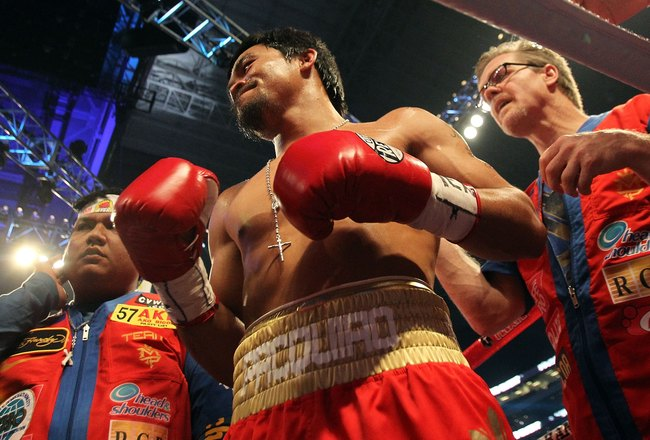 ARLINGTON, TX - MARCH 13:  Manny Pacquiao of the Philippines looks on in the ring with trainer Freddie Roach while taking on Joshua Clottey of Ghana during the WBO welterweight title fight at Cowboys Stadium on March 13, 2010 in Arlington, Texas. Pacquiao