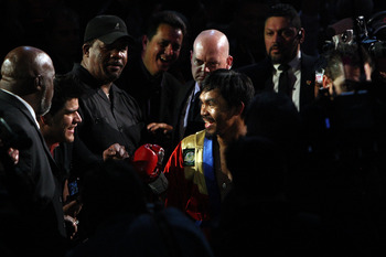 ARLINGTON, TX - MARCH 13:  Manny Pacquiao of the Philippines enters the ring before taking on Joshua Clottey of Ghana during the WBO welterweight title fight at Cowboys Stadium on March 13, 2010 in Arlington, Texas.  (Photo by Jed Jacobsohn/Getty Images)