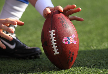 EAST RUTHERFORD, NJ - OCTOBER 17: A general view of the ball with the breast cancer awareness pink ribbon during the game between the New York Giants and the Detroit Lions at New Meadowlands Stadium on October 17, 2010 in East Rutherford, New Jersey.  (Ph