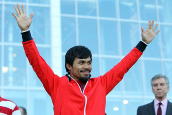 ARLINGTON, TX - MARCH 12:  Manny Pacquiao of the Philippines waves to the crowd during the weigh-in for his WBO welterweight title fight against Joshua Clottey of Ghana outside Cowboys Stadium on March 12, 2010 in Arlington, Texas. Pacquiao and Clottey wi
