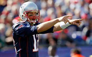 FOXBORO, MA - OCTOBER 17:  Tom Brady #12 of the New England Patriots gestures during a game against the Baltimore Ravens at Gillette Stadium on October 17, 2010 in Foxboro, Massachusetts. (Photo by Jim Rogash/Getty Images)